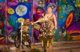 Dame Tanni Grey-Thompson lighting the Paralympic Heritage torch with Kelly Gallagher MBE (Paralympian alpine skier) holding the wheelbarrow at the 2016 event